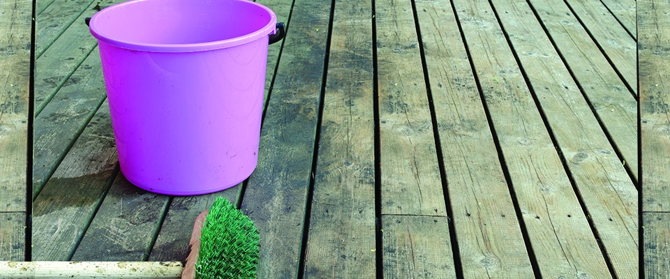 dirty-deck-with-pink-bucket-and-broom